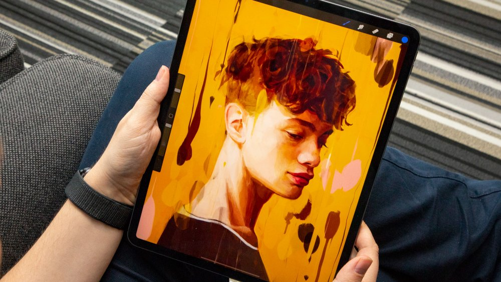 Person holding an iPad Pro 12.9